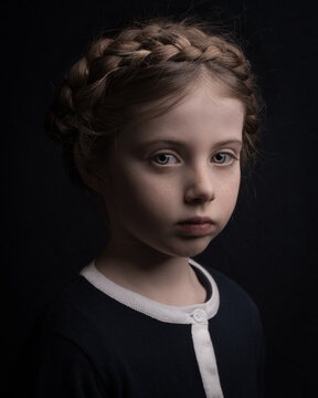 Classic painterly renaissance portrait of a young beautiful  girl with hair in braids