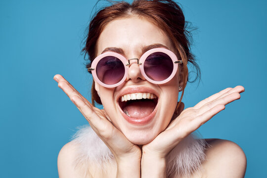 emotional woman wearing dark round glasses naked shoulders decoration closeup isolated background