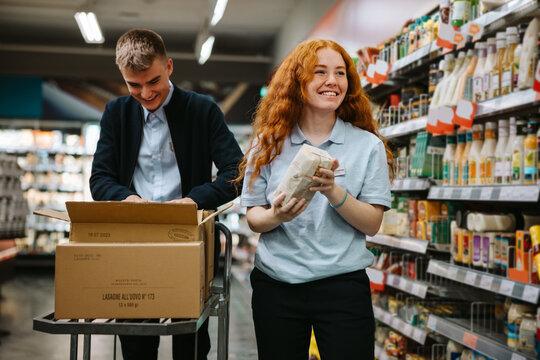 Supermarket employees at work