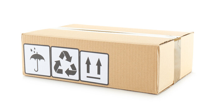 Cardboard box with shipping label isolated on white