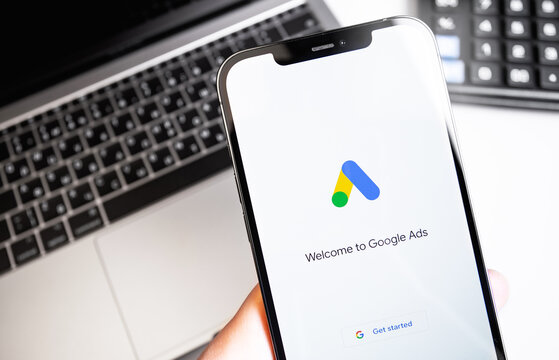 Google Ads (AdWords) logo on the screen iPhone, notebook background. Google is the biggest Internet search engine in the world. Moscow, Russia - December 5, 2020