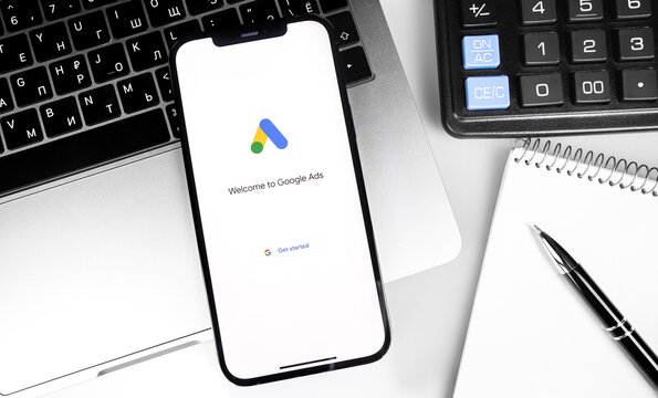 Google Ads (AdWords) logo on the screen iPhone, notebook, calculator background. Google is the biggest Internet search engine in the world. Moscow, Russia - December 5, 2020