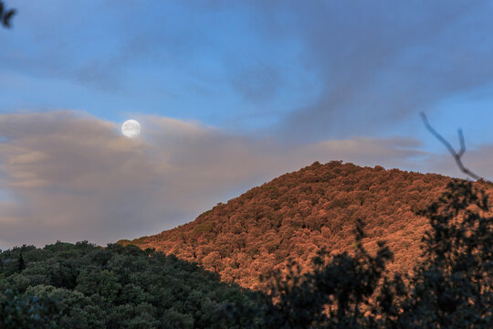 Full moon with mountain at sunrise.Nature elements concept