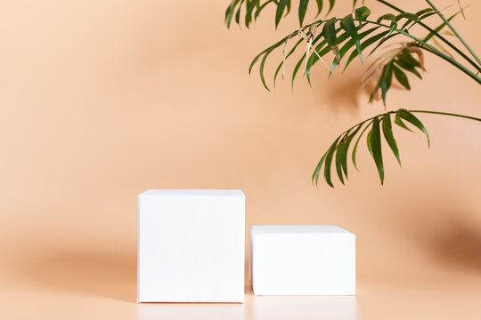 White empty podium stands on light color background.