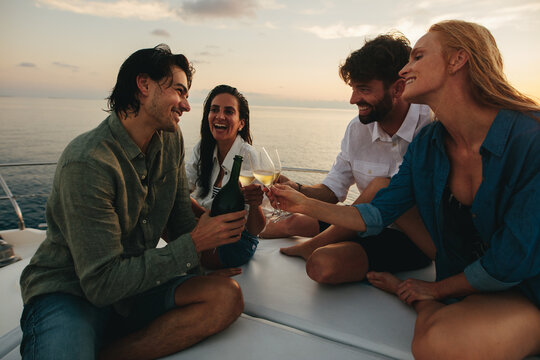 Friends celebrating on a yacht