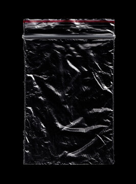 Small Crumpled Plastic Zip Bag Ziplock Lock Zipper Isolated On Black. Grunge Overlay Texture.