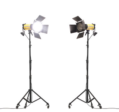 Flash lights with barn doors on stand with wheels. Studio lighting equipment isolated on white background.