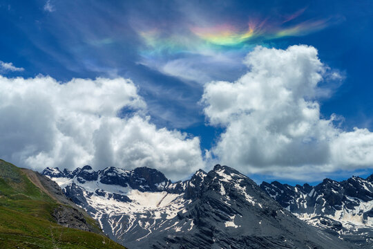 Iridescent cloud over the road to Stelvio pass (Lombardy) at summer