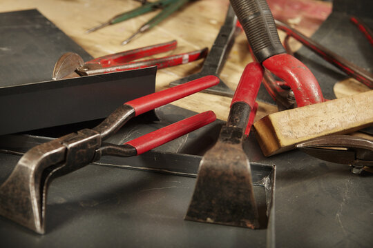 Detail of pliers and trimming tools of roof plumbers on table