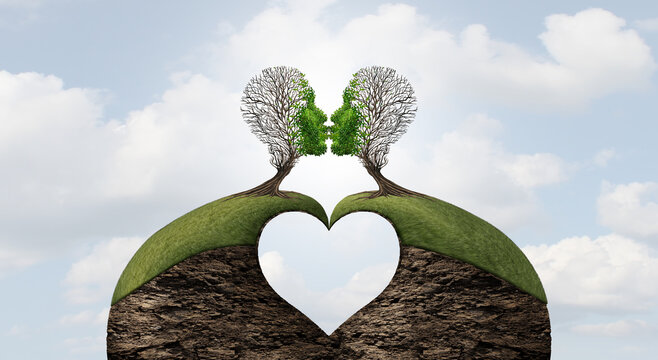 United love valentine concept with a heart shape and the power of romantic emotions or the power of lovers to move mountains as two trees shaped as a head giving a kiss