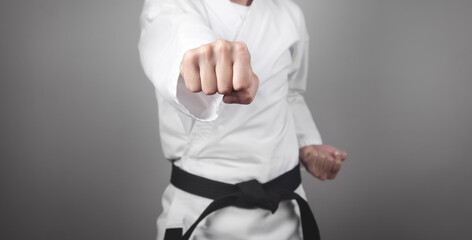 Caucasian male punch. Doing karate. Martial arts