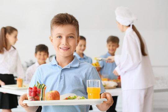 Schoolboy having lunch in school canteen