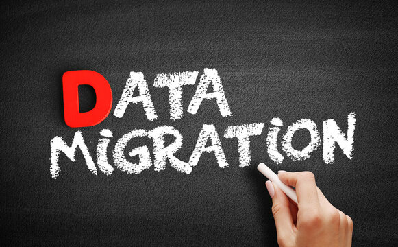 Data Migration text on blackboard, technology concept background