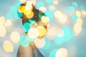 Double exposure portrait of young beautiful african american woman and bokeh lights, modern art