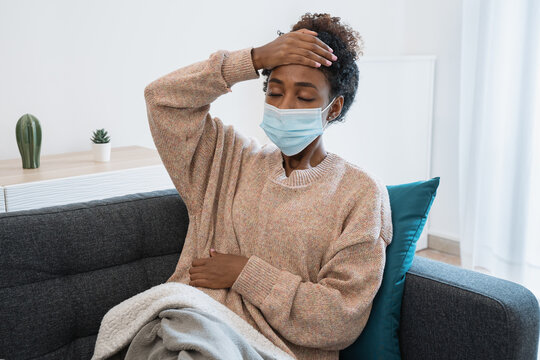 Black girl having flu, feeling bad and lying on the sofa