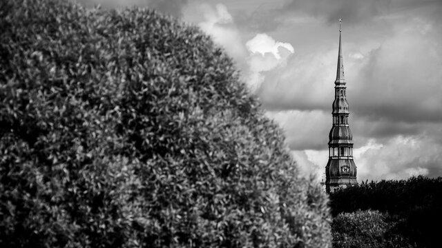 Saint Peter church's tower rising in Riga skyline.