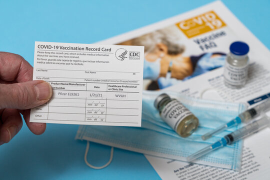 Morgantown, WV - 21 January 2021: Covid-19 vaccination record card showing first dose of Pfizer vaccine