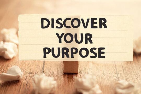 Discover your purpose, text words typography written on paper against wooden background, life and business motivational inspirational