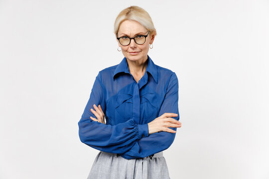 Blonde confident responsible employee business woman 40s wearing blue classic shirt glasses formal clothes hold hands crossed folded isolated on white background studio portrait Achievement concept
