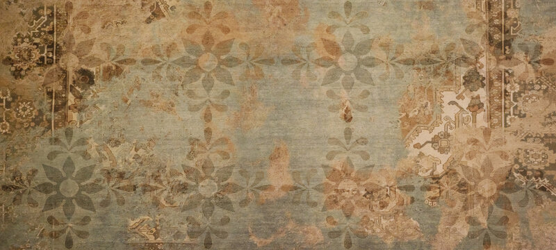 Old brown gray rusty vintage worn shabby patchwork floral flower leaves motif tiles stone concrete cement wall texture background banner
