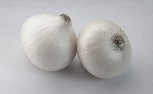 Heads of white onion on a white background
