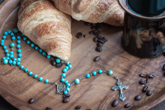 Rosary and coffee and croissants