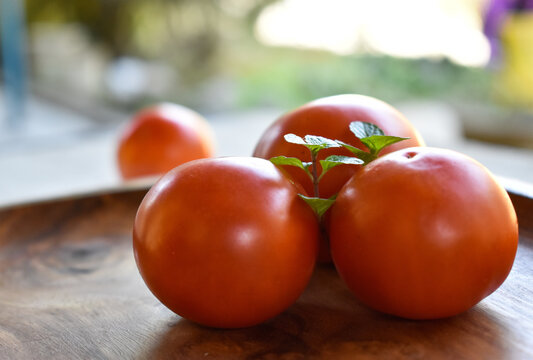 Closeup shot of fresh tomatoes on cutting board