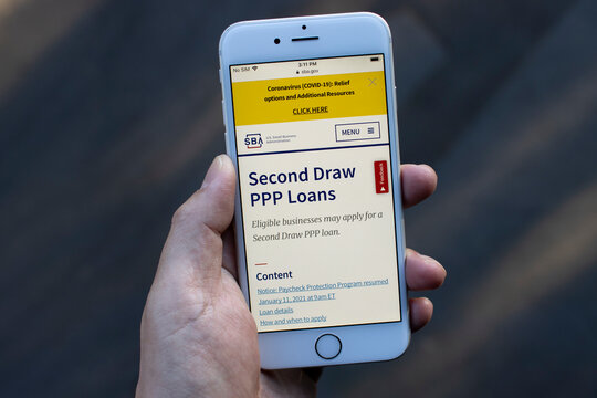 Portland, OR, USA - Jan 22, 2021: The U.S. Small Business Administration website's Second Draw PPP Loans page is seen on a phone. PPP loan helps businesses keep their workforce employed.