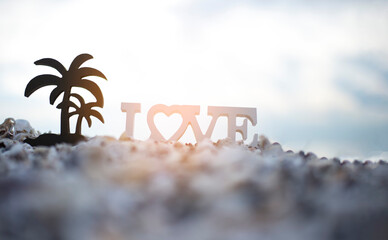 The Beach symbol of a heart in the sand at sunset.Happy Valentine's Day