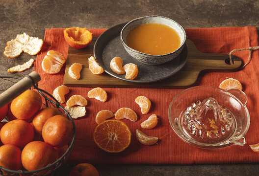 Squeezed mandarin juice in vintage composition