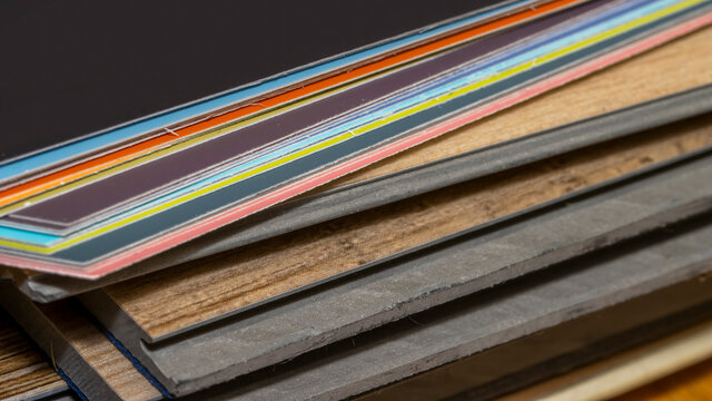 Vinyl plank samples and color samples for home flooring and paint selections