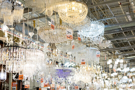 02 december,2020. Omsk, Russia. crystal strass lamp white over blurred background, luxury interior design.Luxurious Crystal chandelier Lamp on the Ceiling, Elegant Vintage Style Decoration.