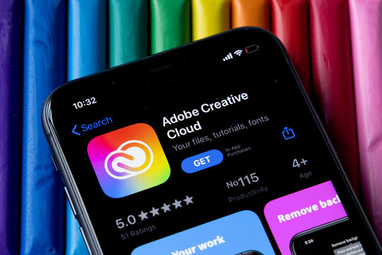 Mobile Adobe creative cloud app on appStore with a colorful plasticine background. Installing creative cloud on the iPhone.