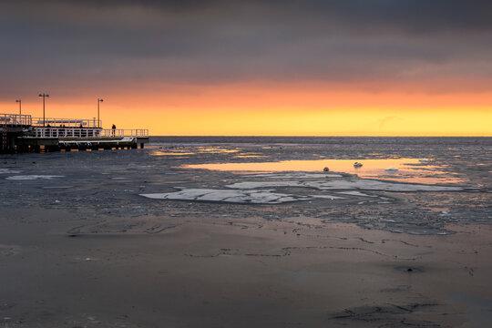 Beach in Jastarnia village on Hel Peninsula at sunset time. Winter landscape. Poland.