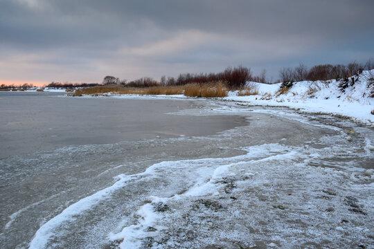 Frozen and snowy beach in Jastarnia on the Hel Peninsula. Poland