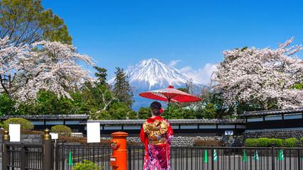 Wall Mural - Asian woman wearing japanese traditional kimono at Fuji mountain and cherry blossom in spring, Fujinomiya in Japan.