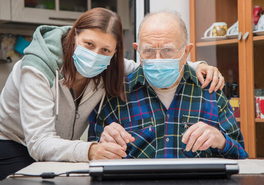 Senior Man with their Caregiver at Home during Coronavirus Pandemia.