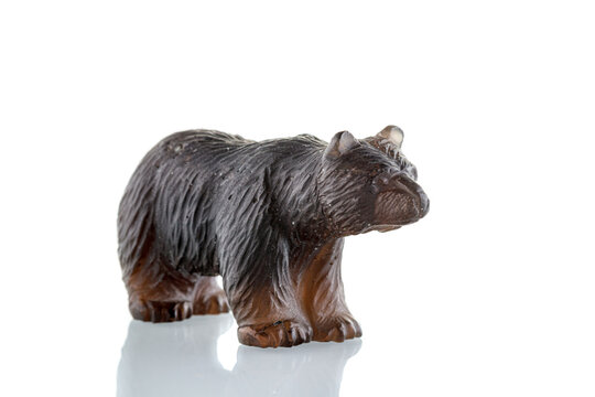 beautiful figurine of a bear made of smoky quartz on a white background