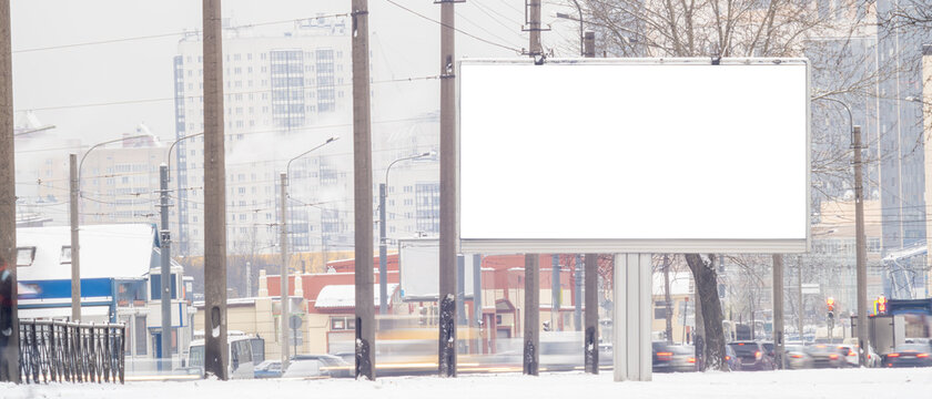 billboard in winter .MOCKUP with white advertising space near the road