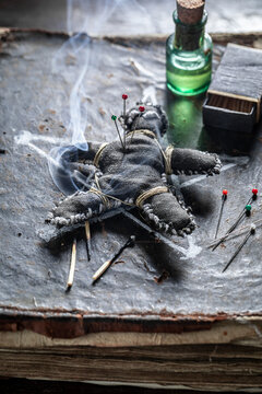 Voodoo doll, poisoned, burns and stabbed with a needle
