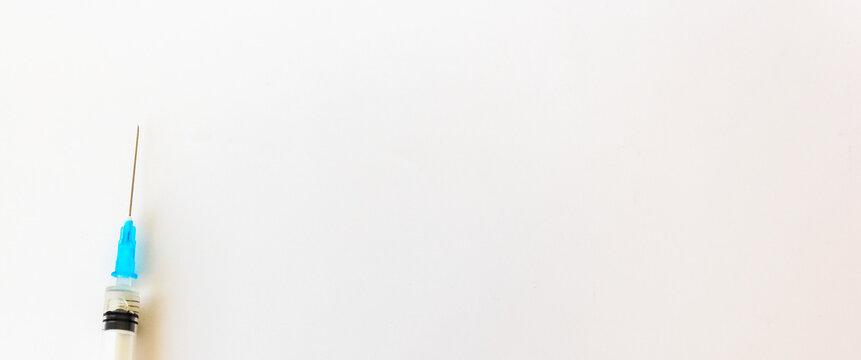 Syringe and 5 ml needle isolated on white background. Place to write