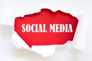Fototapeta SOCIAL MEDIA written under torn paper.
