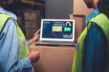 Warehouse management software application in computer for real time monitoring of goods package delivery . PC screen showing smart inventory dashboard for storage and supply chain distribution .