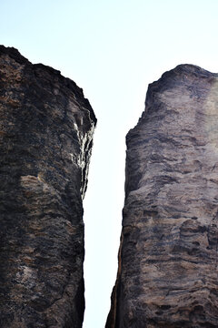 Vertical shot of a narrow hole between two big rocks