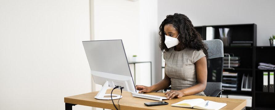 Woman Employee In Office Wearing Face Mask Working