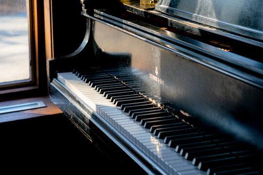 Sun shining on a Steinway piano