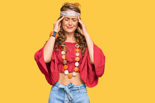 Young blonde girl wearing bohemian and hippie style suffering from headache desperate and stressed because pain and migraine. hands on head.