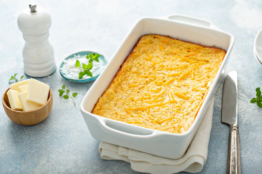 Cheesy cornbread freshly baked in a pan, southern food