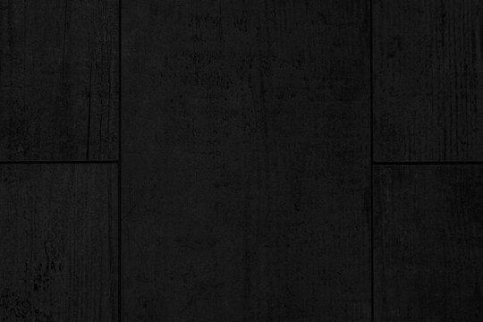 Black sandstone floor tiles texture and background seamless