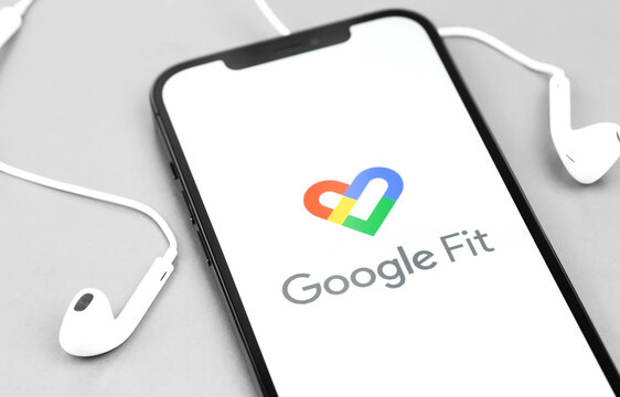 Google Fit app on the screen smartphone with headphones. Google Fit is a health tracking platform developed by Google. Moscow, Russia - December 5, 2020
